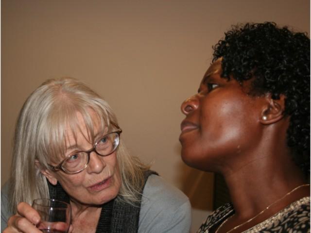 Vanessa chats to an asylum seeker after a fundraising concert